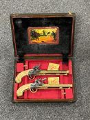 A pair of replica duelling pistols in fitted case