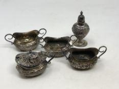 An ornate Victorian five piece silver condiment set, Walker & Hall,