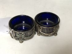 A pair of Neo-Classical silver salts with blue glass liners.