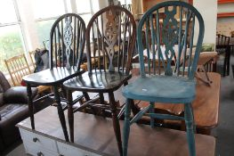 Three Windsor style dining chairs