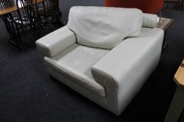 A contemporary white leather armchair