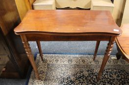 A nineteenth century mahogany tea table CONDITION REPORT: Legs rather wobbly.