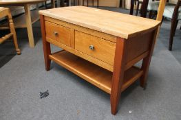 A light oak two drawer low table CONDITION REPORT: 78cm wide by 42cm deep by 50cm