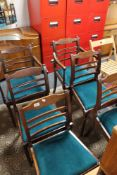 A set of four inlaid mahogany dining chairs