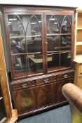 A mahogany double door bookcase fitted with three cupboards