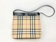 A Burberry Check Leather small handbag, with black shoulder strap and press-stud opening,