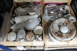 Two crates of china plates, cutlery, gilded tea china,