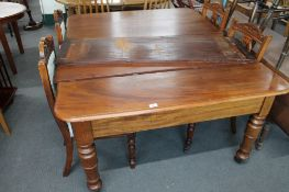 A Victorian mahogany extending dining table with leaf and four dining chairs,