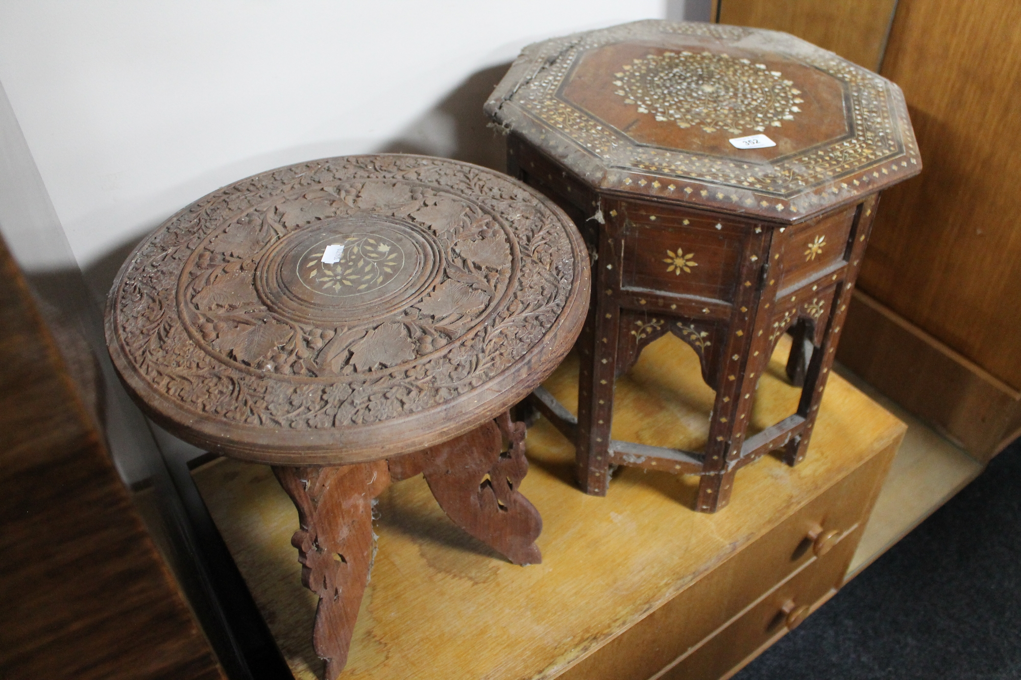 Lot 352 - An antique eastern inlaid ivory folding table and further carved table