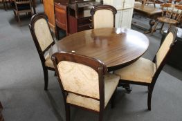 An antique oval occasional table and four 19th century mahogany dining chairs.