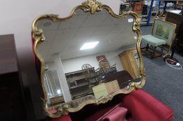 A gilt framed ornate mirror