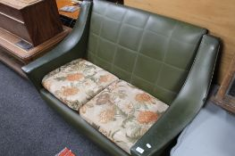 A mid century green vinyl two seater settee