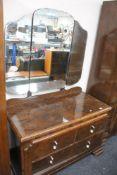 An early twentieth century figured walnut wardrobe and dressing table