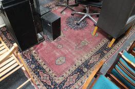An antique fringed eastern carpet