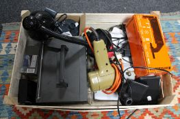 A box of Black & Decker tool, portable radio, table lamp,