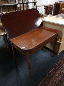 A Victorian inlaid mahogany tea table