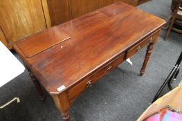 A Victorian mahogany two drawer side table