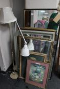 Two floor lamps together with pictures and mirrors