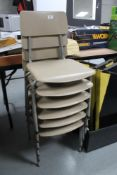 A stack of six mid century school chairs