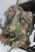 Three army rucksacks