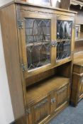 A carved oak display cabinet