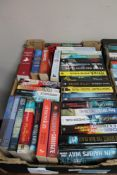 A box of paperback books