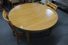 A formica topped kitchen table and two chairs