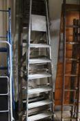 An aluminium ladder and wooden ladder