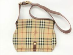 A Burberry Check Leather handbag, with brown shoulder strap and press-stud flap,