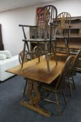 An oak refectory style dining room table together with a set of six Windsor style chairs