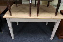 A pine farmhouse table with painted legs