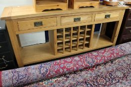 A contemporary light oak kitchen sideboard with bottle rack CONDITION REPORT: 180cm