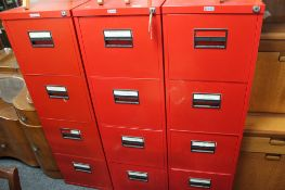 Three red metal four drawer filing chests
