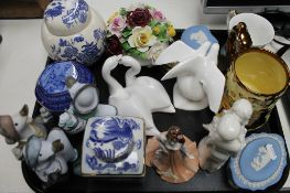 A tray of china ornaments, Doulton figures,