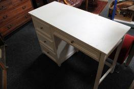 A white contemporary four drawer desk