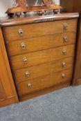 An early twentieth century oak five drawer chest