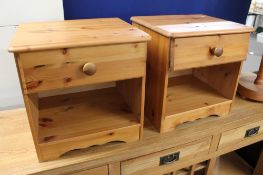 A pair of pine bedside stands