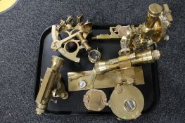 A collection of brass surveying instruments, compass, sextant,