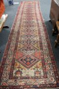 An antique Persian runner CONDITION REPORT: 487cm by 112cm.