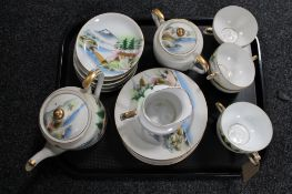 An early 20th century Japanese coffee set with geisha decoration
