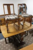 An early 20th century oak six piece dining room suite