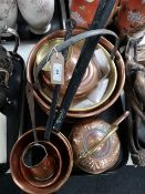 A tray of antique and later copper, saucepans,