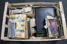 A crate of stamp albums,