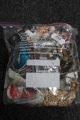 A bag of costume jewellery