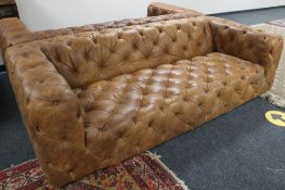 A brown studded leather Chesterfield style settee CONDITION REPORT: This is a pair