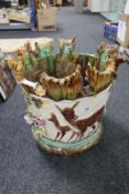 An encrusted potter planter decorated with fawns etc
