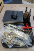 A tray of cutlery, cigarette case,