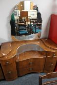 An early 20th century walnut mirrored dressing table