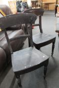 A pair of antique dining chairs