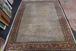A fringed eastern carpet of geometric design